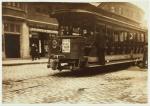 Street kid on a Boston trolley in 1906