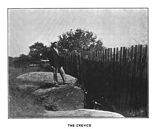 Sidney Perley at rocky crevice near Salem Witch Trials execution Site